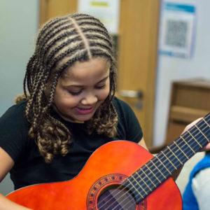 Guitar-lesson-girl